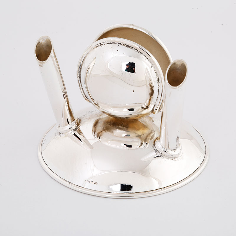 Silver Pen Stand: Bestow your working desk an elegant silver pen stand that not only escalate the  beauty of your desk but also offer your working area with a touch of regalness.