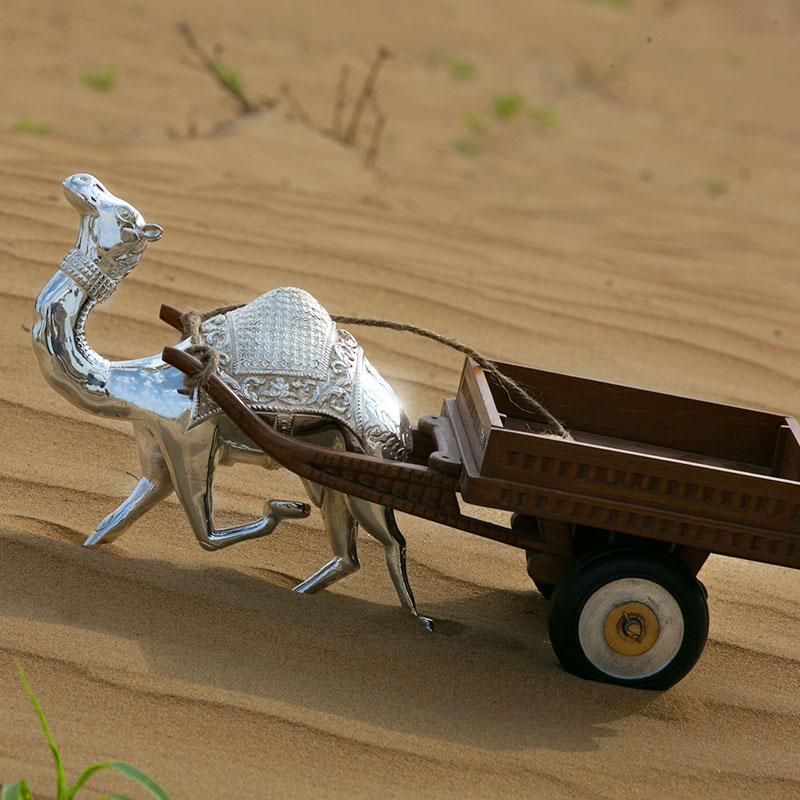 Silver Camel: Let the silver ship of the desert adorn your home with its shine and incredible  design. The Silver Camel by Durga Silver Works is sure to be the center of attraction at your place.